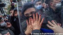 Women protesters clash with Turkish policemen during a demonstration against Turkey's withdrawal from Istanbul Convention, an international accord designed to protect women, in Istanbul, on March 20, 2021. - Thousands protested in Turkey on March 20, 2021, calling for President Recep Tayyip Erdogan to reverse his decision to withdraw from the world's first binding treaty to prevent and combat violence against women. (Photo by BULENT KILIC / AFP) (Photo by BULENT KILIC/AFP via Getty Images)
