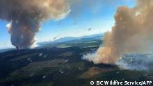 This handout photo courtesy of BC Wildfire Service shows two plumes of smoke from the Long Loch wildfire (K51040) and the Derrickson Lake wildfire (K51041), British Columbia, on June 30, 2021. - Multiple fires have broken out in British Columbia and evacuation orders have been issued for the village of Lytton, which has set a new temperature record by reaching 121 degrees Fahrenheit (49.5 degrees Celsius) in recent days. The scorching heat stretching to Canada's Arctic territories has been blamed on a high-pressure heat dome trapping warm air in the region. (Photo by - / BC Wildfire Service / AFP) / RESTRICTED TO EDITORIAL USE - MANDATORY CREDIT AFP PHOTO / BC Wildfire Service - NO MARKETING - NO ADVERTISING CAMPAIGNS - DISTRIBUTED AS A SERVICE TO CLIENTS