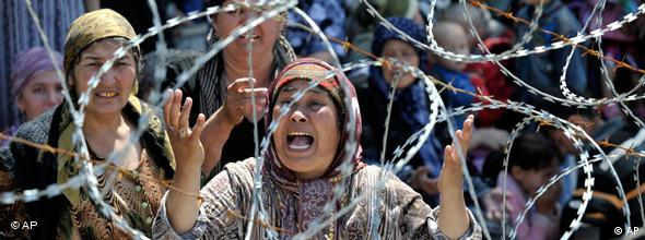 Uzbek woman Matluba, centre, who says she fled from the southern Kyrgyz city of Osh