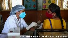 A health worker administers the Covishield vaccine during a special vaccination drive against COVID-19 in Hyderabad, India, Tuesday, June 29, 2021. (AP Photo/Mahesh Kumar A.)