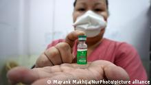 A healthcare worker holds a vial containing doses of COVISHIELD, a coronavirus (COVID-19) vaccine, manufactured by Serum Institute of India, at a vaccination centre, in New Delhi, India on July 1, 2021. Nine European nations are accepting Covishield vaccines for travel to their countries, namely Austria, Germany, Slovenia, Greece, Iceland, Ireland, Spain, Estonia and Switzerland. The EU's Digital Covid certificate or 'Green Pass' is coming into effect on Thursday with an aim to facilitate free movement during the COVID-19 pandemic. (Photo by Mayank Makhija/NurPhoto)