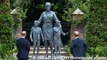 Britain's Prince William, left and Prince Harry unveil a statue they commissioned of their mother Princess Diana, on what woud have been her 60th birthday, in the Sunken Garden at Kensington Palace, London, Thursday July 1, 2021. (Dominic Lipinski /Pool Photo via AP)