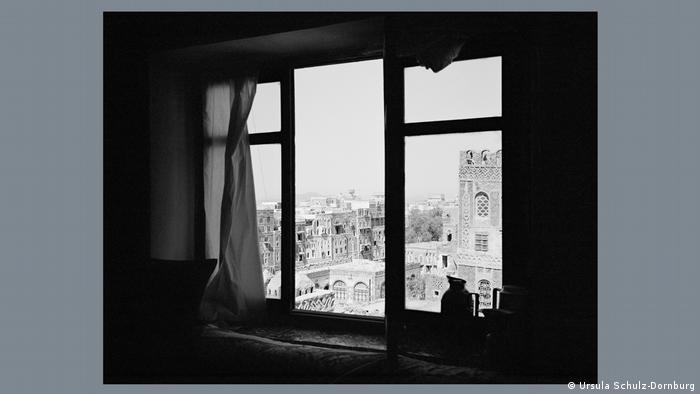 View through a window of the historic old city of Sanaa with its unique multi-storey houses.