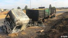 A burnt truck is seen on the side of the road in Manzini, Eswatini, on June 30, 2021. - Demonstrations escalated radically in Eswatini this week as protesters took to the streets demanding immediate political reforms. Activists say eight people were killed and dozens injured in clashes with police. Internet access has been limited while shops and banks are shuttered, straining communication and limiting access to basic goods under a dawn-to-dusk curfew. (Photo by - / AFP)
