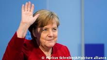 German Chancellor Angela Merkel waves as she attends a virtual discussion with students about the future of Europe at the chancellery in Berlin, Germany, Monday, June 28, 2021. (AP Photo/Markus Schreiber, Pool)