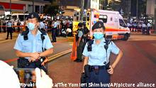 01.07.2021 Police offiers keep a guard over a site where a police was stabbed at a shopping street of the Causeway Bay district, in Hong Kong on July 1st, 2021, 24 years after the handover of Hong Kong to the mainland China. According to the security authorities, the police officer's condition remains safe while the man who stabbed attempted to commit a suicide. China marked the centennial anniversary of the China Communist Party (CCP). ( The Yomiuri Shimbun via AP Images )