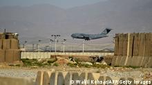 A US Air Force transport plane lands at the Bagram Air Base in Bagram on July 1, 2021. (Photo by WAKIL KOHSAR / AFP) (Photo by WAKIL KOHSAR/AFP via Getty Images)
