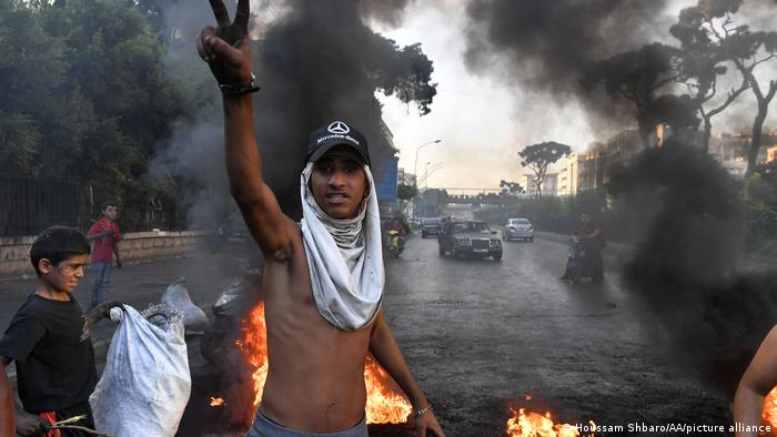 Demonstrators set fire to tires, closing some roads to traffic during a protest against economic conditions and high cost of living, in Beirut.