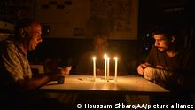 29.06.2021 BEIRUT, LEBANON - JUNE 29: People spend time in the dark during power cuts due to the fuel shortage and problems in the supply of fuel, which is traded in dollars, in Beirut, Lebanon on June 29, 2021. While electricity is given to the capital Beirut for 6 hours a day, it can be given to other regions for 4 hours. Street lights were also not working due to power cuts in the capital. Houssam Shbaro / Anadolu Agency