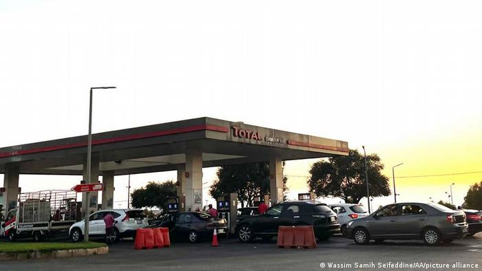 People queue with their cars to buy fuel in Beirut, Lebanon.
