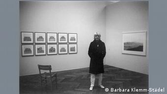 Ursula Schulz-Dornburg standing in the exhibition space.
