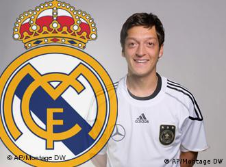 Mesut Oezil with the Real Madrid insignia