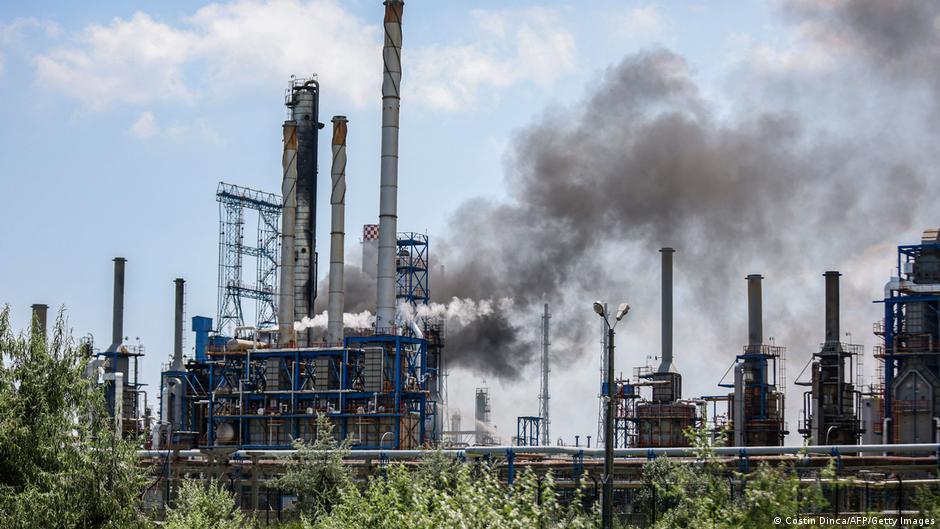 Smoke rises from the Petromidia oil refinery in Navodari, Romania