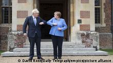 Angela Merkel visit to UK. Prime Minister Boris Johnson welcomes the Chancellor of Germany, Angela Merkel, to Chequers, the country house of the Prime Minister of the United Kingdom, in Buckinghamshire. Picture date: Friday July 2, 2021. See PA story POLITICS Merkel. Photo credit should read: David Rose/Daily Telegraph/PA Wire URN:60698115