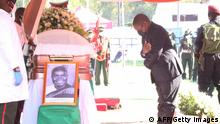 02.07.2021 Mozambique President Filipe Nyusi pays his last respects to the late former Zambian President Kenneth Kaunda during his state memorial service in Lusaka on July 2, 2021. - Mourners waving white handkerchiefs, Kenneth Kaunda's trademark symbol, gathered at a Lusaka stadium on July 2, 2021 for a state memorial service for Zambia's first president, who died last month aged 97. (Photo by - / AFP) (Photo by -/AFP via Getty Images)