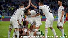 Italian teammates celebrate scoring the opening goal during the Euro 2020 soccer championship quarterfinal match between Belgium and Italy at the Allianz Arena stadium in Munich, Germany, Friday, July 2, 2021. (AP Photo/Matthias Schrader, Pool)