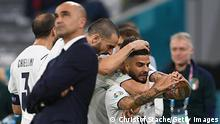 Italy's forward Lorenzo Insigne (R) celebrates scoring the team's second goal during the UEFA EURO 2020 quarter-final football match between Belgium and Italy at the Allianz Arena in Munich on July 2, 2021. (Photo by Christof STACHE / POOL / AFP) (Photo by CHRISTOF STACHE/POOL/AFP via Getty Images)