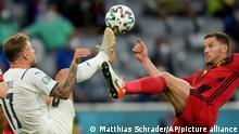 Italy's Ciro Immobile, left, and Belgium's Jan Vertonghen challenge for the ball during the Euro 2020 soccer championship quarterfinal match between Belgium and Italy at the Allianz Arena stadium in Munich, Germany, Friday, July 2, 2021. (AP Photo/Matthias Schrader, Pool)