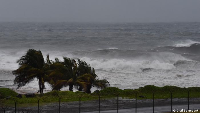 Waves churn and wind blows trees as Hurricane Elsa approaches Argyle, St. Vincent