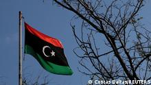 FILE PHOTO: A Libyan flag flutters atop the Libyan Consulate in Athens, Greece, December 6, 2019. REUTERS/Costas Baltas/File Photo