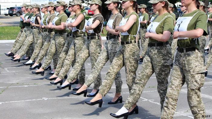 Ukrainian female soldiers march in heels