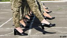 A handout photograph taken and released by the Ukrainian Defence ministry press-service on July 2, 2021 shows the Ukrainian female soldiers wearing heels while taking part in the the military parade rehearsal in Kiev. - Ukrainian authorities found themselves under fire on July 1, 2021 over their idea of making female soldiers marching with court shoes instead of combat boots during a military parade scheduled for August. The scandal erupted after the Defense Ministry released photos of a rehearsal of the parade to be held to mark the 30th anniversary of Ukraine's independence on August 24. (Photo by - / Ukrainian Defence ministry press-service / AFP) / RESTRICTED TO EDITORIAL USE - MANDATORY CREDIT AFP PHOTO /Ukrainian Defence ministry press-service - NO MARKETING - NO ADVERTISING CAMPAIGNS - DISTRIBUTED AS A SERVICE TO CLIENTS