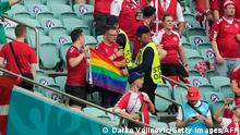 Stewards intervene on a Denmark supporter who was holding up a rainbow flag before the UEFA EURO 2020 quarter-final football match between the Czech Republic and Denmark at the Olympic Stadium in Baku on July 3, 2021. (Photo by Darko Vojinovic / POOL / AFP) (Photo by DARKO VOJINOVIC/POOL/AFP via Getty Images)