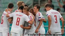 Denmark's forward Kasper Dolberg (C) celebrates with teammates after scoring his team's second goal during the UEFA EURO 2020 quarter-final football match between the Czech Republic and Denmark at the Olympic Stadium in Baku on July 3, 2021. (Photo by Darko Vojinovic / POOL / AFP) (Photo by DARKO VOJINOVIC/POOL/AFP via Getty Images)