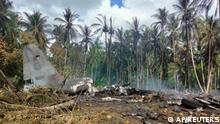This photo released by the Joint Task Force - Sulu shows the remains of a Philippine military C-130 plane that crashed in Patikul town, Jolo province, southern Philippines on Sunday, July 4, 2021. The Philippine air force C-130 aircraft carrying troops crashed in a southern province after missing the runway Sunday, killing more than a dozen military personnel while at least 40 were rescued from the burning wreckage, officials said. (Joint Task Force-Sulu via AP)