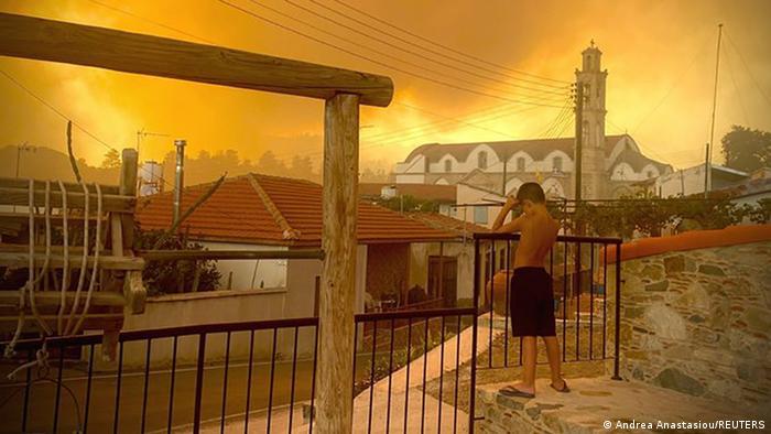 ´Hazy yellow smoke rises behind a village