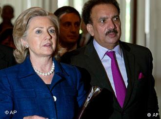 US Secretary of State Hillary Clinton walks with Pakistan's Interior Minister Rehman Malik, right, after their meeting