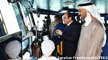 Egyptian President Abdel Fattah al-Sisi (C) stands next to Abu Dhabi's Crown Prince Sheikh Mohammed bin Zayed al-Nahyan (R) in a control tower during the inauguration of the new July 3 naval base, in Marsa Matruh Egypt, July 3, 2021. in this handout picture courtesy of the Egyptian Presidency. The Egyptian Presidency/Handout via REUTERS ATTENTION EDITORS - THIS IMAGE WAS PROVIDED BY A THIRD PARTY