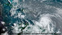 This satellite image provided by the National Oceanic and Atmospheric Administration shows Hurricane Elsa moving through the Caribbean, over Barbados, Tuesday, July 2, 2021, at 12:00 Z (8am a.m. ET). Elsa was expected to pass near the southern coast of Hispaniola on Saturday and to move near Jamaica and portions of eastern Cuba on Sunday. (NOAA/NESDIS/STAR GOES via AP)