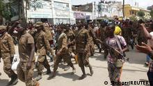 Ethiopian government soldiers and prisoners of war in military uniforms walk through the streets of Mekelle, the capital of Tigray region, Ethiopia July 2, 2021. Picture taken July 2, 2021. REUTERS/Stringer NO RESALES. NO ARCHIVES.