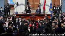 Constituent assembly representatives celebrate after the inaugural session of the Constitutional Convention, at the Congress building in Santiago, Chile, Sunday, July 4, 2021. Following a May election, mainly independent politicians and members of the indigenous people will draft a constitution to replace one that has governed it since being imposed during a military dictatorship in 1980. (AP Photo/Esteban Felix)