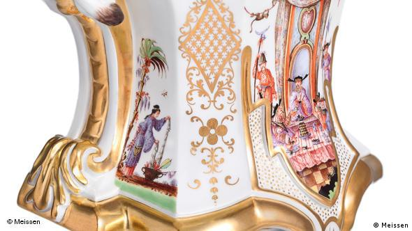 This detail shot shows the base of Meissen's anniversary clock with scenes reminiscent of Asian art