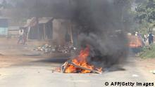 A barricade in the road that is on fire is seen in Mbabane, Eswatini, on June 29, 2021. - Demonstrations escalated radically in Eswatini this week as protesters took to the streets demanding immediate political reforms. Activists say eight people were killed and dozens injured in clashes with police. Internet access has been limited while shops and banks are shuttered, straining communication and limiting access to basic goods under a dawn-to-dusk curfew. (Photo by - / AFP) (Photo by -/AFP via Getty Images)