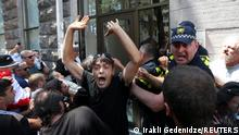 Protesters storm the office of LGBT+ campaigners at a rally against the planned March for Dignity during Pride Week in Tbilisi, Georgia July 5, 2021. REUTERS/Irakli Gedenidze