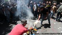 Anti-LGBT protesters burn a rainbow banner as they take part in a rally ahead of the planned March for Dignity during Pride Week in Tbilisi, Georgia July 5, 2021. REUTERS/Irakli Gedenidze