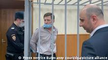 6477739 03.03.2021 In this handout photo released by the press service of the Basmanny court, former Khabarovsk region governor Sergei Furgal, centre, charged with organizing murders waits inside a defendants' cage before a hearing on extending his arrest at the Basmanny Court, in Moscow, Russia. Editorial use only, no archive, no commercial use. The press service of the Basmanny court