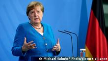 German Chancellor Angela Merkel addresses the media after a virtual 'summit of the Berlin process on the western Balkans 2021' in Berlin, Germany, Monday, July 5, 2021. (AP Photo/Michael Sohn, pool)