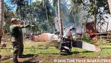 View of the site after a Philippines Air Force Lockheed C-130 plane carrying troops crashed on landing in Patikul, Sulu province, Philippines July 4, 2021. Picture taken July 4, 2021. Armed Forces of the Philippines - Joint Task Force Sulu/Handout via REUTERS ATTENTION EDITORS - THIS IMAGE HAS BEEN SUPPLIED BY A THIRD PARTY. NO RESALES. NO ARCHIVES