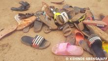 Shoes of abducted boarding school students lie on the floor after 140 boarding students of Bethel Baptist School were kidnapped by gunmen in Kaduna, northwestern Nigeria, on July 5, 2021. - Gunmen kidnapped 140 students from a boarding school in northwestern Nigeria on July 5, 2021, a school official said, the latest in a wave of mass abductions targetting schoolchildren and students. (Photo by Kehinde Gbenga / AFP)