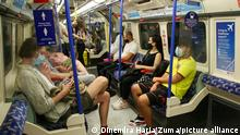 June 13, 2021, London, UK, UK: London, UK. Commuters wearing face coverings travelling on the underground. Prime Minister Boris Johnson may delay the final lifting of coronavirus lockdown restrictions in England amid a rise in Covid-19 cases of the Delta variant. A final decision is expected to be taken today ahead of a formal announcement by the Prime Minister at a news conference on Monday. (Credit Image: © Dinendra Haria/London News Pictures via ZUMA Wire