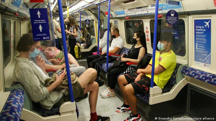 People with masks in the Tube in London