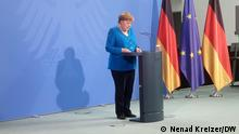 German Chancellor Angela Merkel addresses the media after a virtual 'summit of the Berlin process on the western Balkans 2021' in Berlin, Germany, Monday, July 5, 2021.