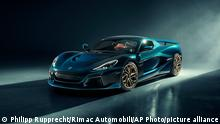 This handout photo provided by Rimac Automobili shows a Rimac Nevera electric car, at an undisclosed location in Croatia, April 15, 2021. Croatia's electric supercar maker is taking over the iconic French manufacturer Bugatti in a deal that is reported to be worth millions of euros. The Croatian car producer, Rimac Automobili, says that Germany's Volkswagen Group, including the Porsche division — which owns a majority stake in Bugatti — is to create a new joint venture which will be called Bugatti-Rimac. (Philipp Rupprecht, Rimac Automobili via AP)