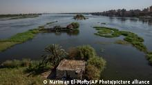 A general view of the Nile River in Beni Suef, Egypt, Tuesday, Aug. 4, 2020. Egypt's farmers already face severely stretched water resources due to years of mismanagement and increasing population. Now they worry about the impact of Ethiopia's massive dam project on the Blue Nile, the main tributary feeding the Nile River. No one is sure what effect the dam will have, but many farmers already see the Nile waters they once used to irrigate their fields diverted and they watch their fields drying up. (AP Photo/Nariman El-Mofty)