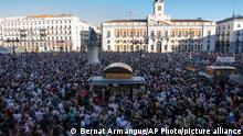 Thousands gather to protest against the killing of Samuel Luiz in the Puerta del Sol in central Madrid, Spain, Monday, July 5, 2021. Authorities in northwestern Spain are asking for time to fully investigate why a 24-year-old man was beaten to death, a crime that has triggered widespread condemnation because friends of the victim claim he was targeted for being gay. LGBTQ activists have called for protests in dozens of cities across Spain later on Monday and members of Spain's left-wing Cabinet have condemned the death of Samuel Luiz in the early hours of Saturday as a hate crime. Police are reviewing surveillance cameras and questioning over a dozen suspects and witnesses who saw how Luiz was beaten to death outside a nightclub in the city of A Coruña. The death comes amid a spike in attacks on LGBTQ people. (AP Photo/Bernat Armangue)