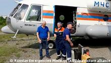 KAMCHATKA TERRITORY, RUSSIA - JULY 6, 2021: Pictured in this video grab are a search and rescue team boarding an Emercom Mil Mi-8 helicopter for a flight to Palana, Kamchatka Territory to take part in a search operation for a missing Antonov An-26 passenger aircraft. The search and rescue team includes rescue workers, a specialised fire and rescue unit of the Kamchatka Territory Emergencies Ministry, medical workers of the regional Centre for Emergency Medicine and a task force of the Kamchatka Territory Emergencies Ministry's Main Directorate. The Antonov An-26 passenger aircraft operated by the Petropavlovsk-Kamchatsky Air Enterprise disappeared off radar on the afternoon of 6 July 2021 during a flight from Petropavlovsk-Kamchatsky to Palana. According to the Russian Emergencies Ministry, the aircraft had 28 people on board, including 22 passengers and 6 crew members. Best possible quality. Video grab. Russian Emergencies Ministry/TASS A STILL IMAGE TAKEN FROM A VIDEO PROVIDED BY A THIRD PARTY. EDITORIAL USE ONLY